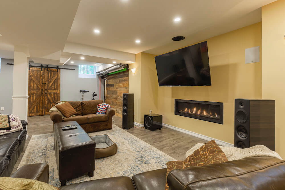fireplace with tv & acoustic system in Toronto basement