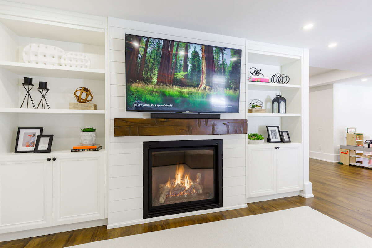 basement with tv & fireplace in Toronto